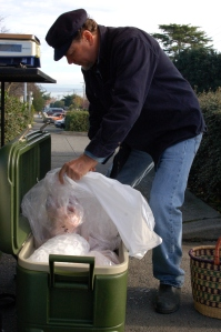 Farmer Theodore, of Olympic Pastured Poultry, hauls out the turkey.